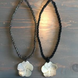 Two shell/beaded necklaces